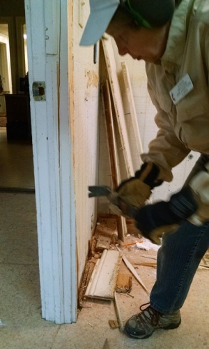 Anne removing door trim