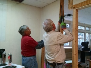 Frank and Max removing wall