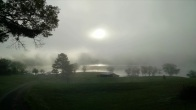 Sun over the foggy lake