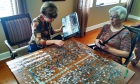 Anne and Nancy working on the puzzle