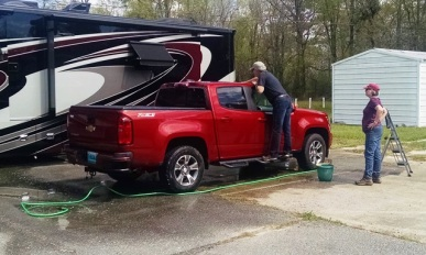 Rita decided she would wash their truck after they arrived