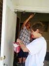 Suzanne and Anne painting church doors