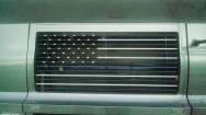 A retired police officer had this police flag painted on his grill while he was here.