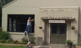 Contractor installing new windows in Dining Hall
