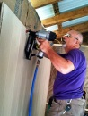 Dave installing paneling in new shop