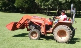 Tractor operator in training
