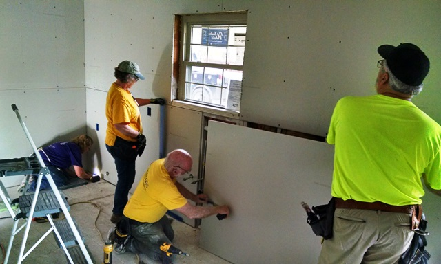 Drywall crew working in the kitchen