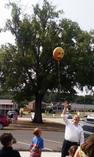 Pastor Harvey used a helium balloon to demonstrate ascension to the children.