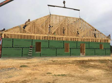 The week 2 Constructors for Christ team was able to hang the rest of the trusses and install much of the sheathing.