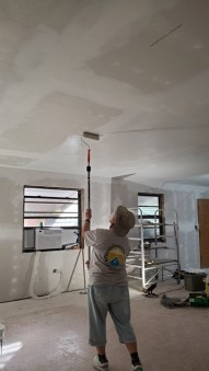 Painting primer on Dennis's ceiling